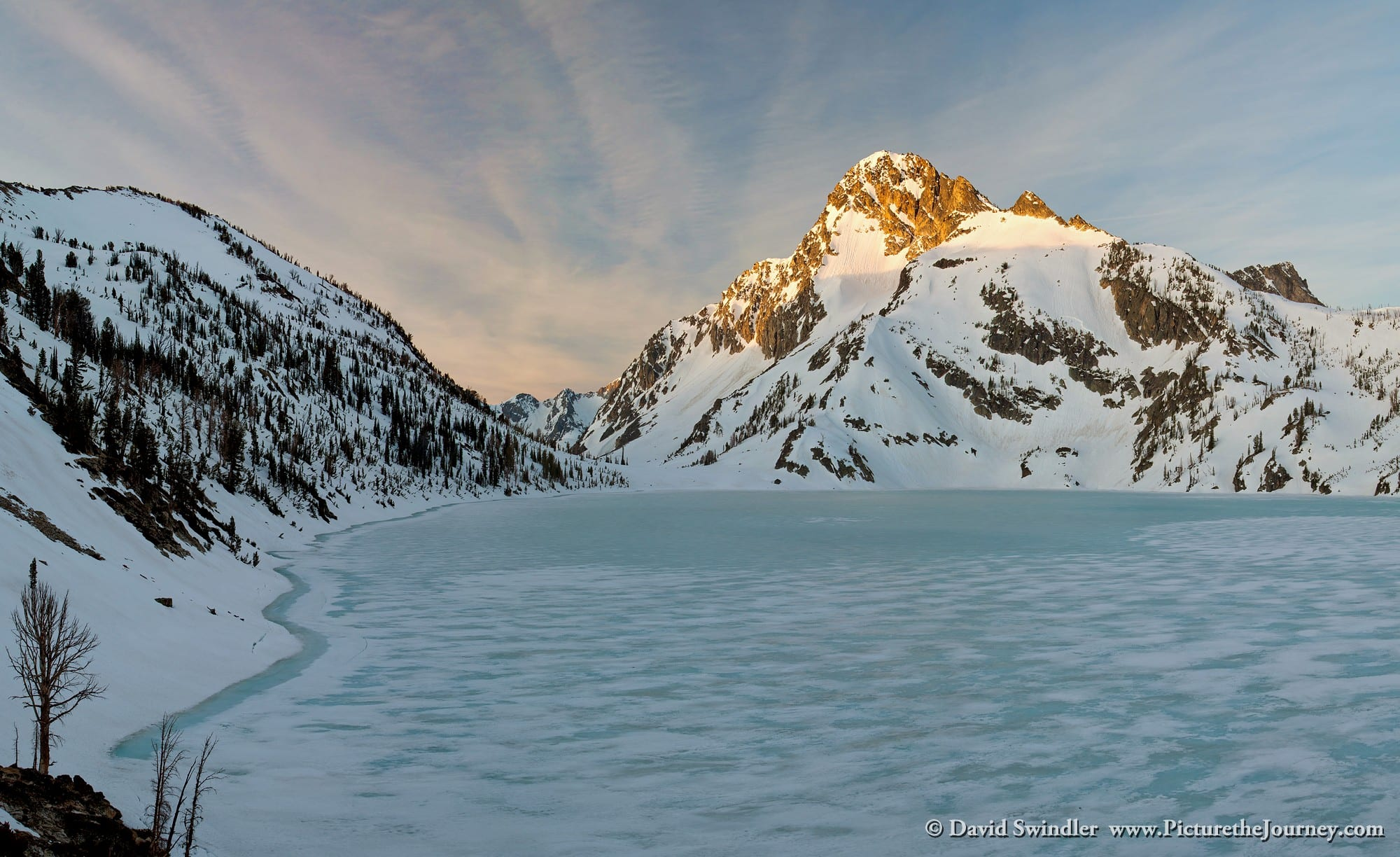 Sunrise over a still frozen Sawtooth Lake.